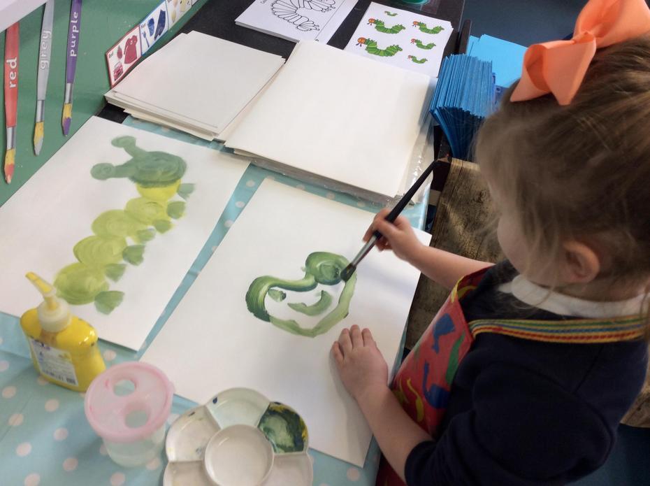 Painting caterpillars.