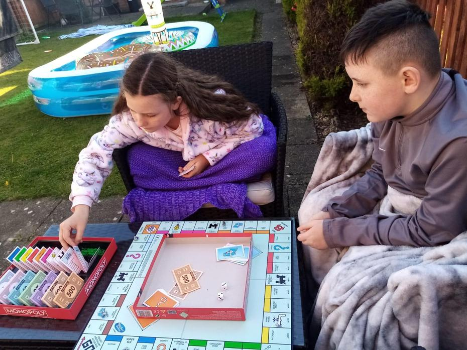 Mollie and Alfie playing Monopoly