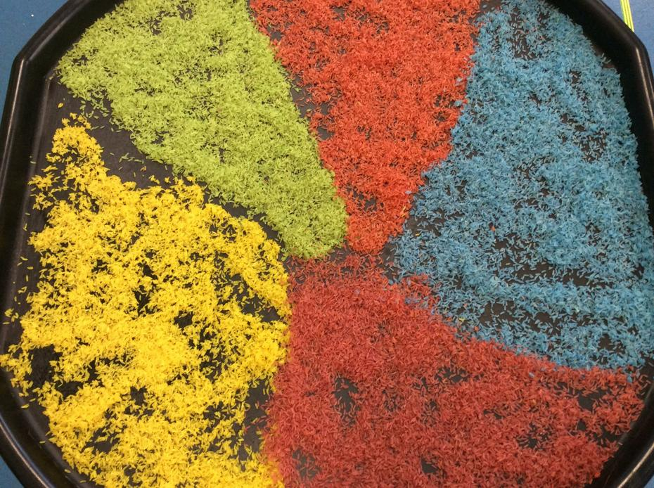 Happy Diwali, coloured rice for Rangoli patterns.
