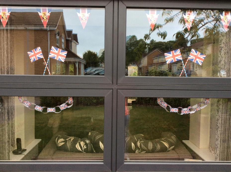 Home made bunting, flags and paperchains.