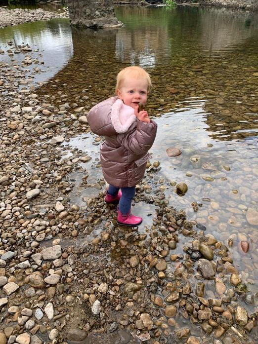 Having fun throwing stones into the river!