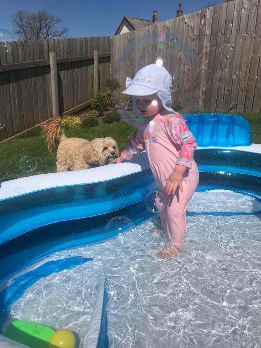 Splashing and sliding in the paddling pool