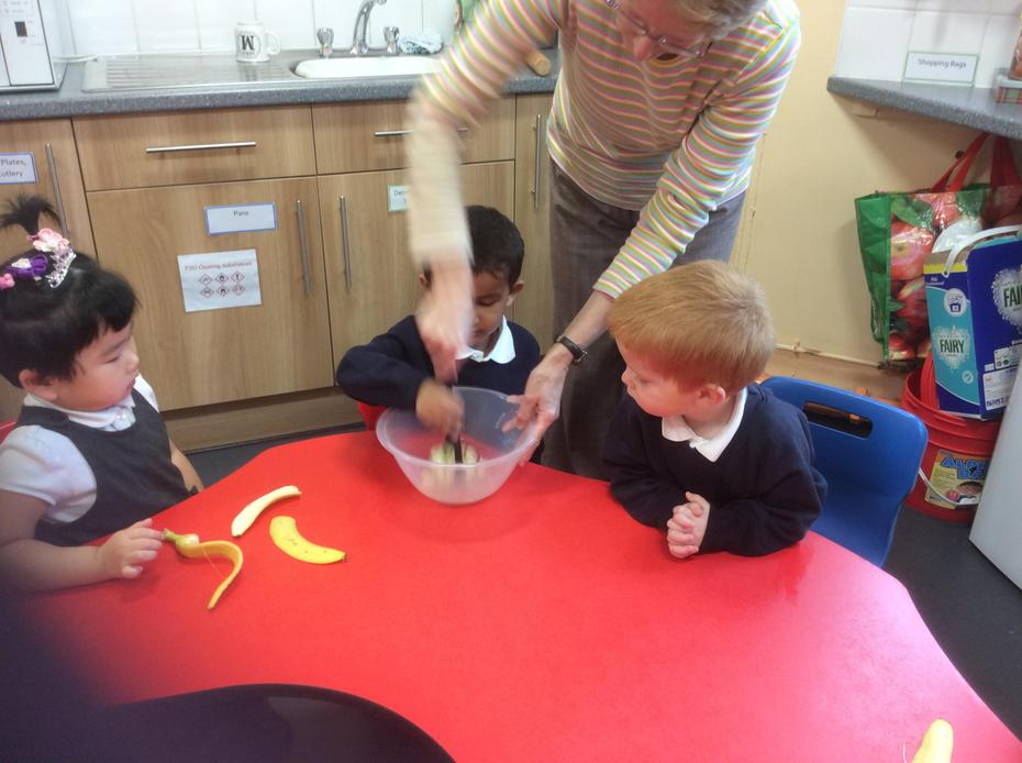 Mashing the banana.