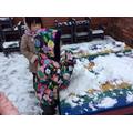 Making smaller snowmen.