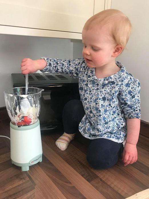 Making ice lollies with fruit and Greek yogurt :)