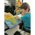 Using an atlas to look at continents