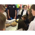 Year 6 learning about CPR and defibrillators
