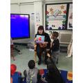 Miss Kettridge reading to Nursery