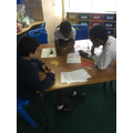 Practising their Times Tables playing maths games