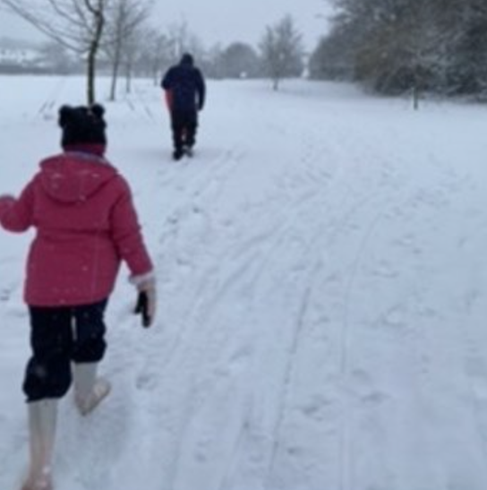 Mrs Cook went for a walk in the snow with her family.