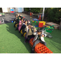 We act out Maths stories. Here we were adding more to join a bus journey - All Aboard!