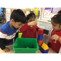 We know the difference between shapes and sing songs to help us remember their names.