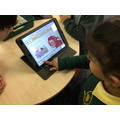 Using IT to enhance learning to read and listen to stories.