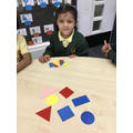 We like to name the shapes that we use and sort.