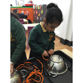 Threading is helping our coordination and fine motor skills