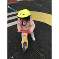Learning to ride the balance bike.