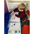 Sorting 3D shapes.