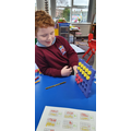 Using the ten frame to make teens numbers.