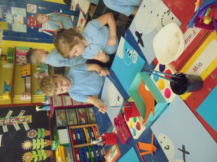 Some of us decided to paint the snowman's hat while others created a hat out of material.
