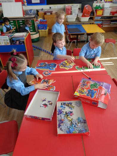 Completing jigsaws.