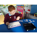 Ordering numerals to 20 using magnetic numbers and a mini whiteboard
