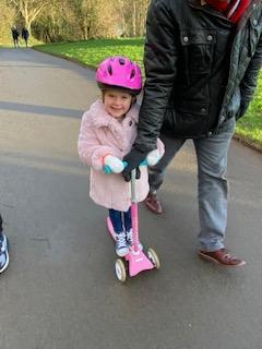 Going out on her scooter makes Izzy feel good.