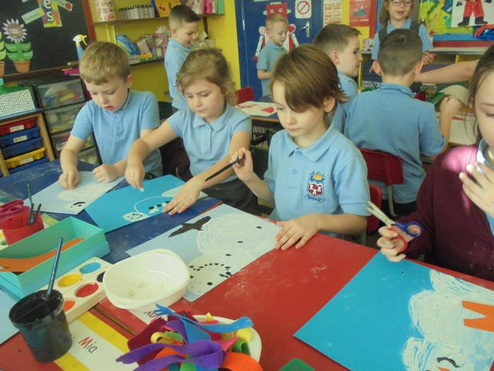 We used felt to make the snowmens scarves.