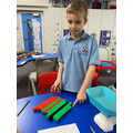 Use suitable non-standard units to estimate and measure the weight of an object