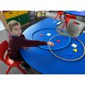Recording shapes using a Venn diagram.