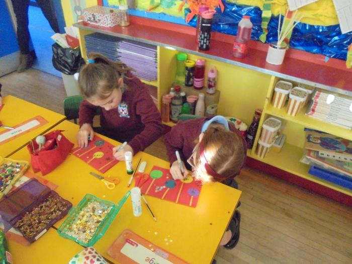 We decorated our cards with sequins, glitter, sparkly stars and our own drawings.