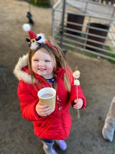Heidi is VERY HAPPY with toasted mallows & hot chocolate at the farm on a Christmas trail