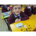 We are learning to total amounts and give change.