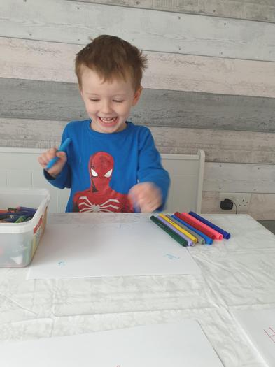 Archie is happy when he is drawing
