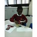 The children worked hard using their cutting skils