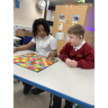 Following rules through play.