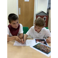 Working together and drawing pictures of the Town.