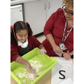 Learning to write letters through sensory activities