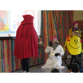 Little red riding hood being acted out in assembly