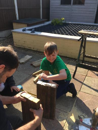 Hard at work developing carpentry skills.