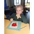 All pupils in KS2 create poppies for the community