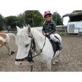 Sienna riding a horse!