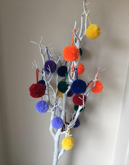 How many pom poms in my tree? (Estimate then count.)