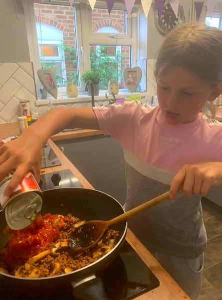 Mya cooking her spaghetti bolognese