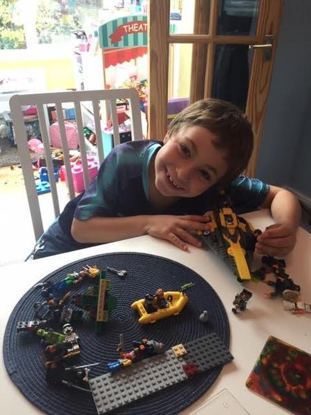 Maxwell busy building LEGO