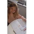 Amber writing her leaflet