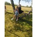 Chloe and Layla climbing trees