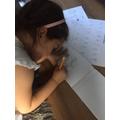 Tilly practising her spellings