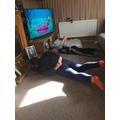 Enya enjoying Cosmic Kids Yoga