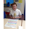 Lily with her trophy from the Royal Mail