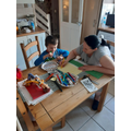 Mason and his mom making Times Tables Flowers